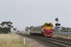 P12 leads a down Wyndham Vale push-pull service towards Deer Park Junction