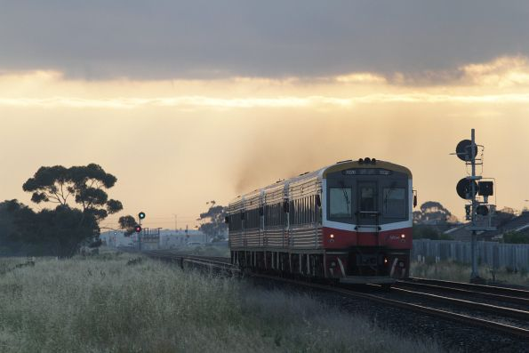 Sprinter 7020 trails three classmates ex-Geelong towards Deer Park station