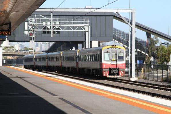 Sprinter 7002 leads four classmates on a down train through West Footscray