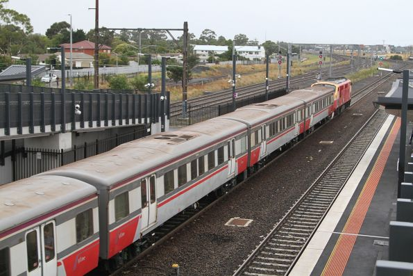 A66 leads an up Bacchus Marsh service out of Sunshine station