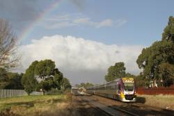 VLocity VL40 and classmate beneath a rainbow on the down at Ardeer