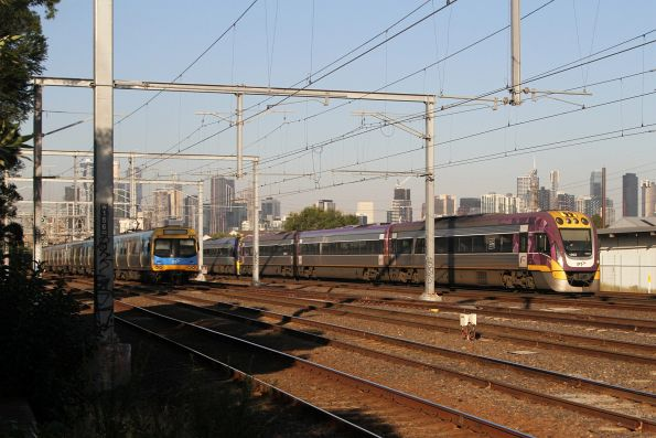 VLocity VL02 passes a citybound suburban train at South Kensington
