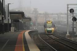 VLocity VL27 arrives into Footscray through the fog on the up