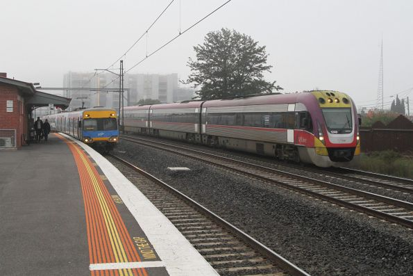 VLocity VL48 parallels a suburban train on the down at Middle Footscray