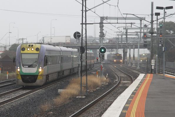 Triple train parallel run citybound at Middle Footscray