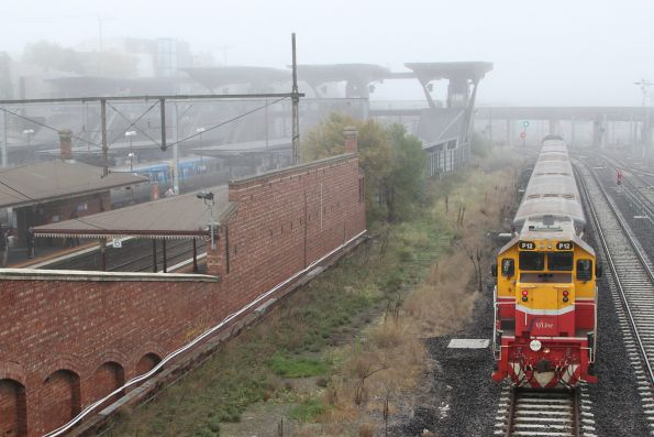 P12 trails a push-pull train past North Melbourne bound for Southern Cross platform 15