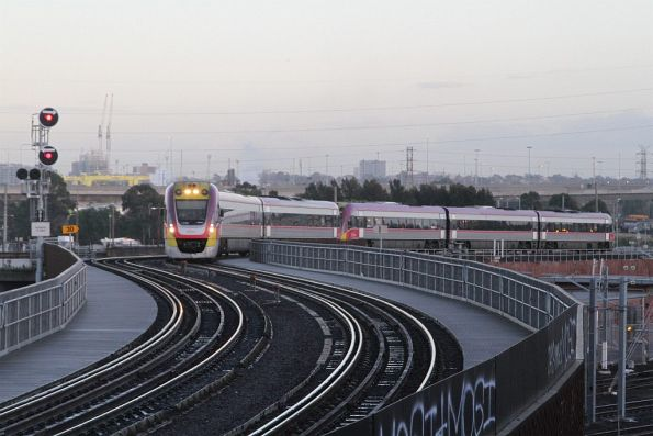 VLocity VL50 and classmate lead an up train over the North Melbourne flyover