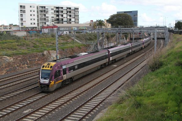 VLocity VL07 and classmate lead an up service out of Footscray