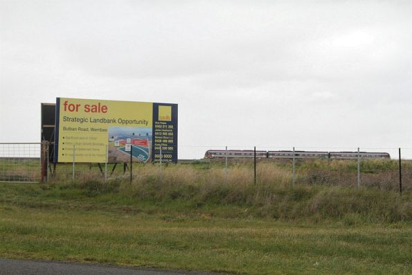 VLocity train at Manor Junction passes development land for sale outside Werribee