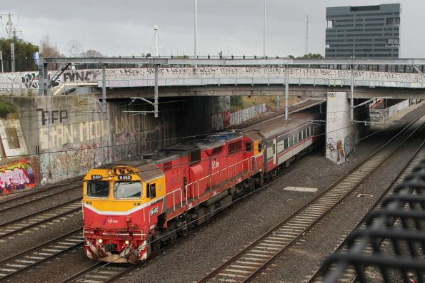 N460 leads an up train out of Footscray