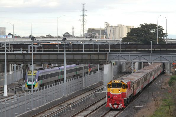 P15 leads an up push-pull train past North Melbourne station