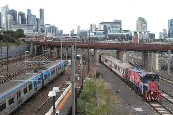 P18 trails an up push-pull train past North Melbourne station