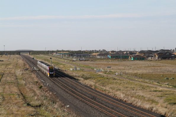Pair of VLocity trains pass new houses west of Tarneit station