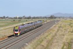 VLocity VL49 trails a down Geelong service between Tarneit and Wyndham Vale