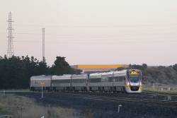 VLocity VL13 and classmate form an up Geelong service at Deer Park Junction