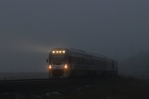 VLocity VL57 emerges from the fog with an up Geelong service at Ravenhall