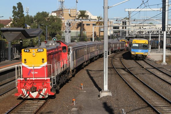 P12 leading a push-pull service runs parallel with an up suburban service at Footscray station
