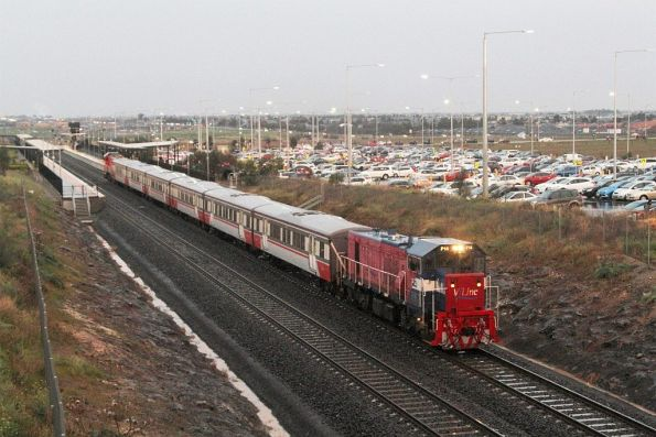 P14 leads P15 out of Tarneit station with a down push-pull service
