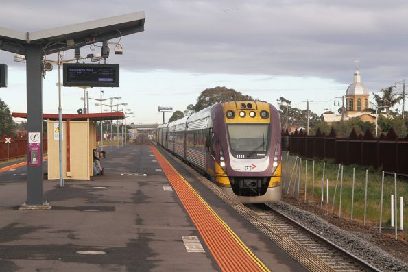 VLocity VL11 and classmate run express through Ardeer station on the up