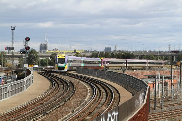 VLocity VL20 and classmate lead an up train over the North Melbourne flyover