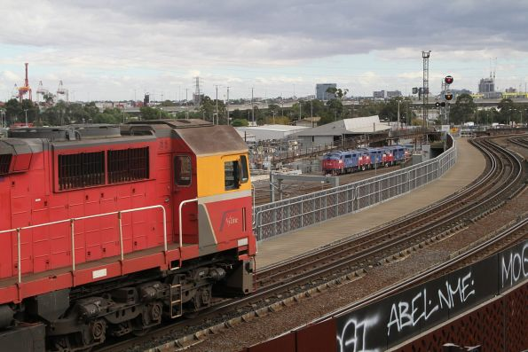 N466 leads a down empty car move over the North Melbourne flyover