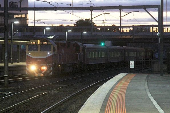 N452 leads a down train into Footscray station