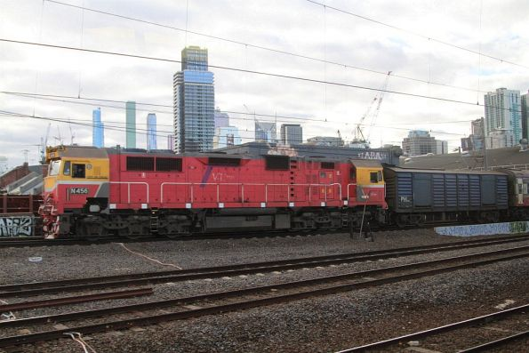 N456 and power van leads a down train out of Southern Cross Station