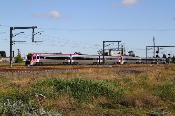 VLocity VL06 and classmate on an up service departs Sunshine