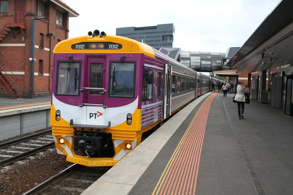 Freshly repainted into PTV livery, Sprinter 7012 leads an up Bacchus Marsh service into Footscray