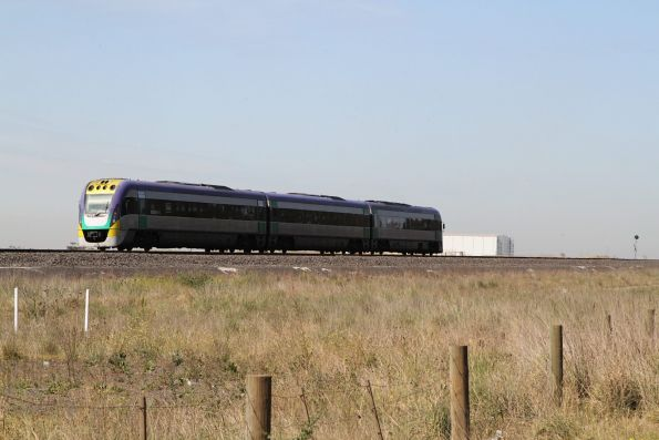 VLocity VL21 leads a down Geelong service away from Deer Park Junction