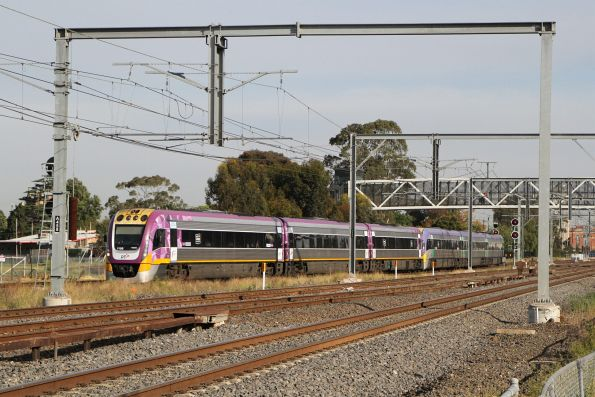 VLocity VL58 and classmate on an up Bendigo service wait for a path onto the RRL tracks at Sunshine