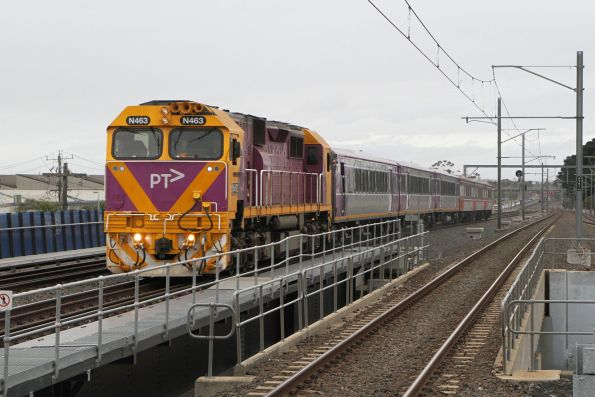 N463 leads a mixed PTV and V/Line liveried consist on the up through Tottenham