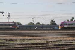 Pair of VLocity trains pass outside Tottenham