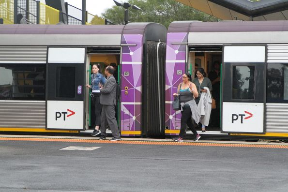 V/Line passengers exit a Melbourne-bound commuter service at Sunshine station
