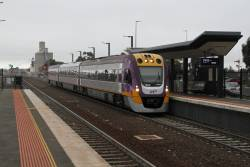 VLocity VL08 runs express through Sunshine on a down Bendigo service