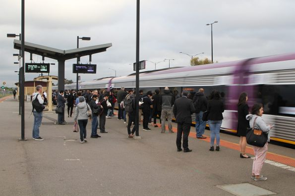 Citybound VLocity train runs express through Deer Park station