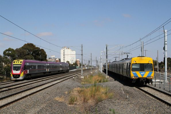 Life extension Alstom Comeng 563M passes VLocity VL50 at West Footscray
