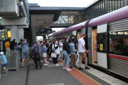 Big crowd of passengers board a VLocity train at Sunshine