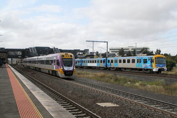 VLocity VL54 on an up Wendouree service parallels Siemens 820M at Sunshine