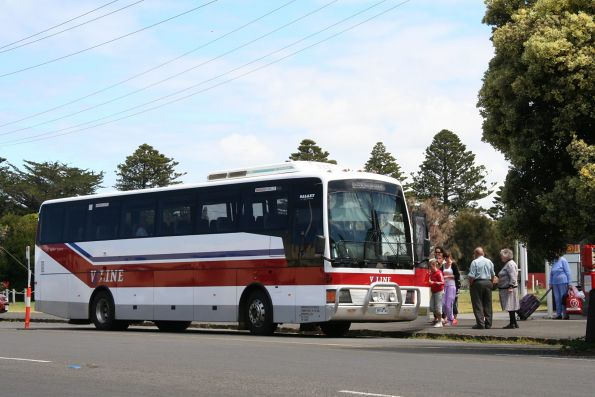 Warrnambool Bus and Motor Co. 3974AO number 97 in V/Line livery picks up passengers at Port Fairy