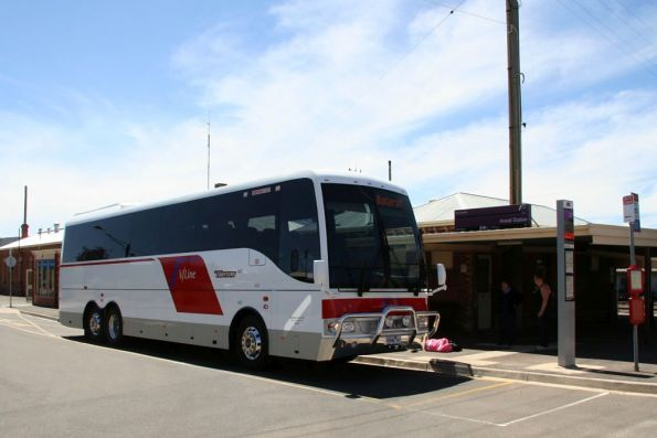 Trotters 6946AO in new V/Line livery picks up passengers at Ararat