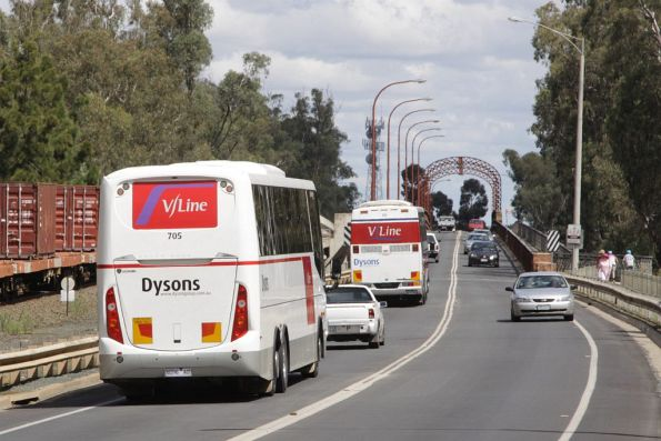 V/Line liveried Dysons buses head back over the border into Victoria at Moama