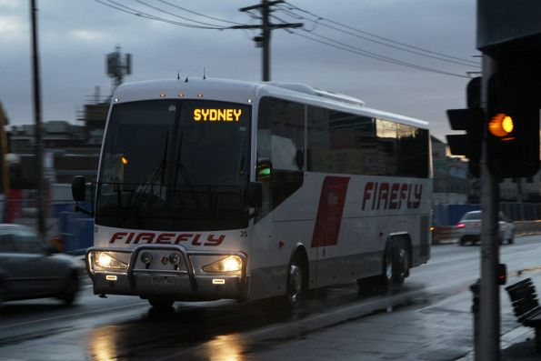 Firefly Express coach #25 rego 5525AO passes Footscray station