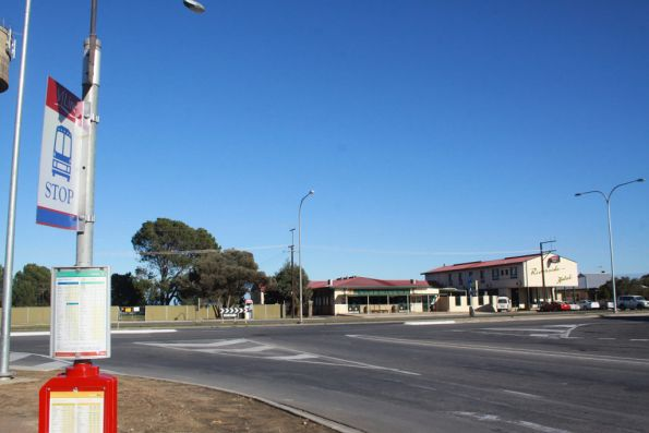 V/Line bus stop at Tailem Bend, while the pub across the road sells West End