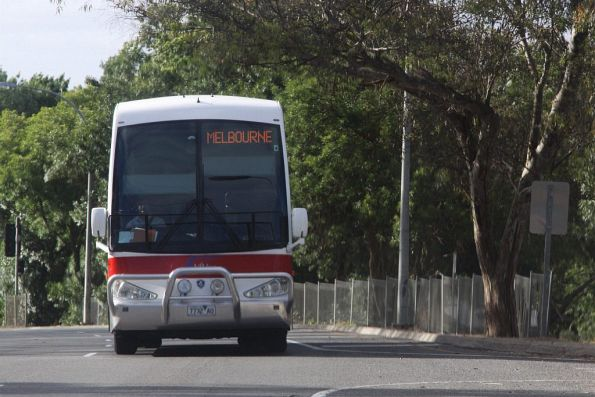 V/Line liveried Firefly bus 7732AO heads for Melbourne at Mount Barker