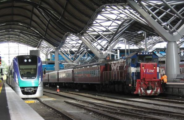 VLocity VL01 alongside P14 and FN carriage set at Southern Cross
