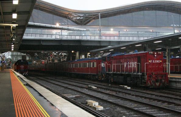 P15 awaits departure on a push-pull special in the rain outside Southern Cross