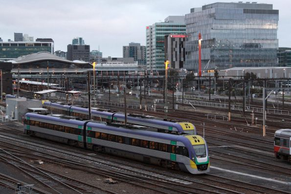 A solo 2 car VLocity departs Southern Cross with a full passenger load