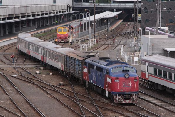 A60 departs Southern Cross with a PH power van and 4-car long carriage set VSH25