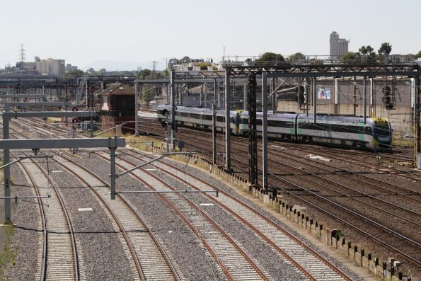VLocity with an up V/Line services crosses onto the country tracks at Franklin Street